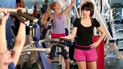 Zooey Deschanel channeled her inner '80s Barbie in a pair of hot pink workout shorts with black banding.