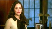 Madeleine Stowe's collared tie-neck top was a fresh take on the '60s secretary staple.