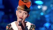 Melanie Martinez sweetened her on-stage style with an oversize orange bow.