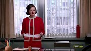 Elisabeth Moss looked ladylike and ready for business on 'Mad Men' in a red contrast trim jacket and matching shift.