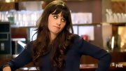 We never tire of Zooey's signature banged 'do with curls.