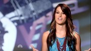 Cassadee Pope's hidden blond highlights add depth to her auburn hair.