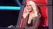 We're sure it's no coincidence Christina Aguilera's glittery bronze blazer was the exact same color as her eyeshadow.