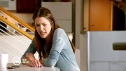Julie Gonzalo may have a sour look on her face, but her heather blue top sure looks comfortable.