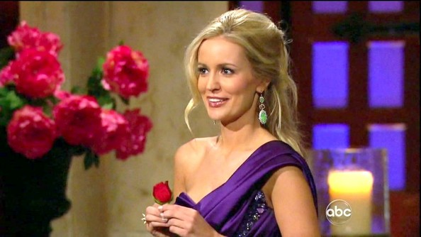Emily Maynard's sparkly green earrings were the perfect complement to her dramatic purple gown.