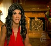 Teresa Giudice loves statement earrings. She added impact to a red dress with these extra-long shoulder dusters.