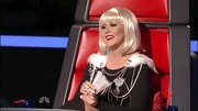 Christina Aguilera jazzed up a simple black sweater with an ornate feathered chain harness.