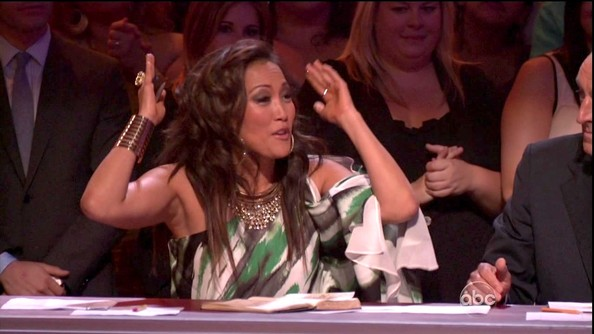 Carrie Ann Inaba jazzed up her chiffon print dress with a statement necklace and a single Wonder Woman-style cuff.
