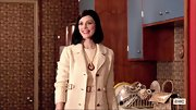 Jessica Pare chose a pale yellow tweed coat and matching sheath dress on 'Mad Men.'