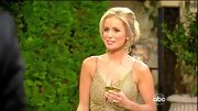Emily Maynard's swept back updo revealed dramatic gold-filigree hoops.
