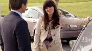 Zooey looked ultra-girly in this bow-adorned coat and striped dress.