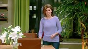 Jamie-Lynn Sigler complemented her olive complexion with a lavender boatneck sweater on 'Guys with Kids.'