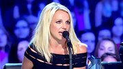 Britney Spears platinum lob pops against her sun-kissed skin.