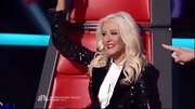Christina Aguilera modified the classic tuxedo with a sequined black blazer and silky white blouse.