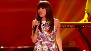 Carly Rae Jepsen kept things sweet on 'So You Think You Can Dance' in a satin floral mini dress and layered statement baubles.