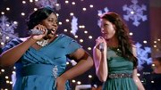 Alex Newell wore a super-pretty frilled, crossover mallard-blue empire-sashed gown on Glee—and coordinated it with a gemstone mic. Cute!