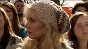 The actress topped off her blonde waves with a knit beanie.