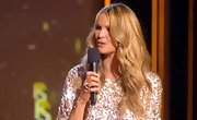 Elle Macpherson's silver cocktail ring grabbed some attention, even against the backdrop of her shimmering top.