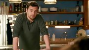 Jake Johnson favors a practical wardrobe on 'New Girl' filled with classic staples like this olive henley.