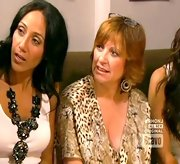 Melissa Gorga ups the drama of a simple white top with a sparkly black statement necklace.